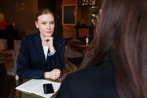 A CPA listening to one of her client