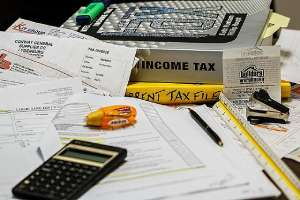 A busy financial office desk. Certified Public Accountants (CPA) are professionals that handle financial tasks