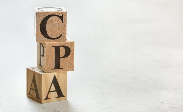 Stack of wooden cubes that read CPA. CPA offers many benefits beyond help with filing your taxes every year