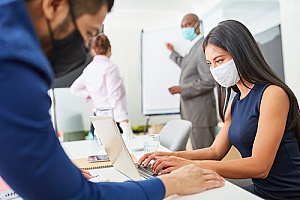 business professionals working in the office during coronavirus