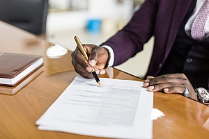 a certified public accountant signing a government contract negotiation