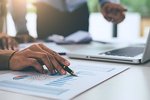a financial report being generated by a Falls Church accounting professional