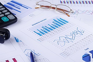 documents and graphs that represent financial reporting services