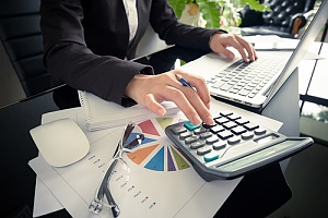 a certified public accountant helping a business owner with their taxes