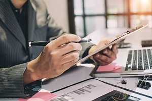 an auditor verifying an organizations compliance with tax laws