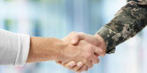 government contract accounting- man shaking hand with military officer