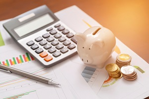 piggy bank and coins for saving money with business stuff