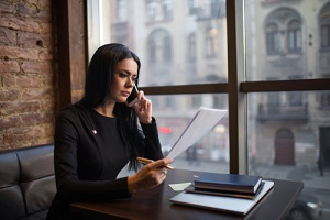 serious successful business woman reading contract summary