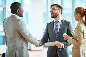 a business owner shaking hands with a certified public accountant after a successful business transaction