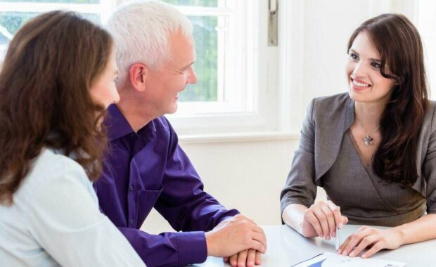 woman and man with business advisor on financial planning