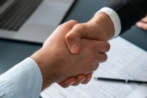 people shaking hands after contract