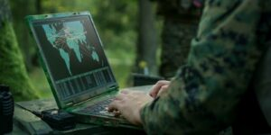 soldiers using military grade laptop targeting enemy with satellite