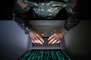 american soldier in military uniform preventing cyber attack in military intelligence center